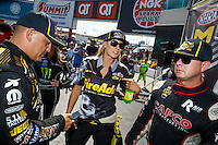 Sep 18, 2016; Concord, NC, USA; NHRA top fuel driver Tony Schumacher (left), Leah Pritchett (center) and Steve Torrence during the Carolina Nationals at zMax Dragway. Mandatory Credit: Mark J. Rebilas-USA TODAY Sports