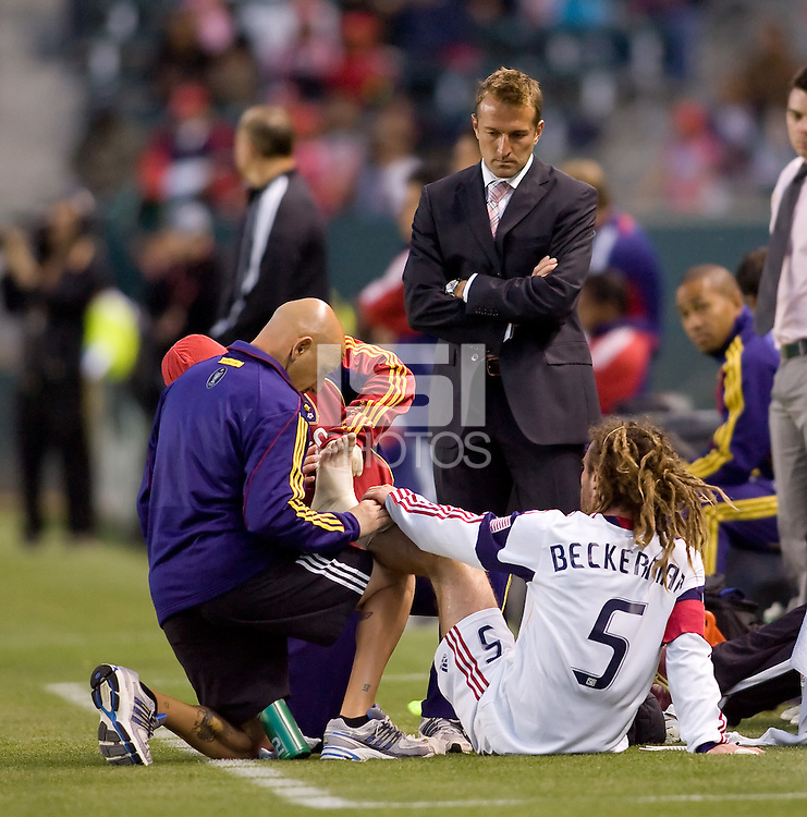 Real Salt Lake Head Coach Jason Kreis looks over his Captain midfielder Kyle Beckerman (5) while being attended to by the trainers. Real Salt Lake defeated CD Chivas USA 2-1at Home Depot Center stadium in Carson, California on Saturday May 22, 2010.  .