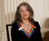 Pianist Martha Argerich, a 2016 Kennedy Center Honoree, listens to US President Barack Obama, in the East Room of the White House, December 4, 2016, Washington, DC. The 2016 honorees are: Argentine pianist Martha Argerich; rock band the Eagles; screen and stage actor Al Pacino; gospel and blues singer Mavis Staples; and musician James Taylor.<br /> Credit: Aude Guerrucci / Pool via CNP