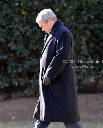 Washington, D.C. - January 16, 2009 -- United States President George W. Bush walks from the Oval Office as he departs the South Lawn of the White House aboard Marine 1 for his final week-end as President at the presidential retreat at Camp David, Maryland on Friday, January 16, 2009..Credit: Ron Sachs / Pool via CNP