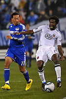 Clyde Simms (white) pulls a muscle and was substituted, Ryan Smith (11)...Kansas City Wizards defeated DC United 4-0 in their season opener, at Community America Ballpark in Kansas City, Kansas.