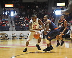 "Ole Miss' Jarvis Summers (32) vs. Auburn guard Josh Wallace (11) at the C.M. ""Tad"" Smith Coliseum on Saturday, February 23, 2013."