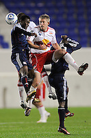 Kenny Mansally (7) of the New England Revolution and John Wolyniec (15) of the New York Red Bulls go up for a header. The New York Red Bulls defeated the New England Revolution 3-0 during a U. S. Open Cup qualifier round match at Red Bull Arena in Harrison, NJ, on May 12, 2010.