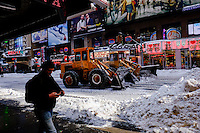 Trucks remove snow from the streets of Times Square after the pass of the winter storm JONAS, in New York, 01/24/2016. Photo by VIEWpress