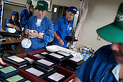 Elderly workers take their bento-box lunch, which the company provides at a cost to each worker of JPN Yen 300, at Kato (a light industry company) in Nakatsugawa, Japan, Monday 21st June 2010. Kato company has a workforce of 100 people, 50% of whom are 60 years of age or older. The elderly work force earn JPN &yen;800-1,000 per hour, but receive no annual bonus or pay rise.