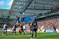 Andrew Durutalo of the USA rises high to win lineout ball. Rugby World Cup Pool B match between Samoa and the USA on September 20, 2015 at the Brighton Community Stadium in Brighton, England. Photo by: Patrick Khachfe / Onside Images