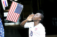 Freddy Adu calls out to fans after the game. USA defeated Grenada 4-0 during the First Round of the 2009 CONCACAF Gold Cup at Qwest Field in Seattle, Washington on July 4, 2009.