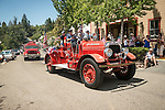 San Andreas Fire Department's historic 1920s Seagrave fire engine. Downtown main street during the Independence Day celebration Main Street, Mokelumne Hill, California