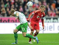 FUSSBALL   1. BUNDESLIGA  SAISON 2011/2012   15. Spieltag FC Bayern Muenchen - SV Werder Bremen        03.12.2011 Andreas Wolf (li, SV Werder Bremen) gegen Philipp Lahm (FC Bayern Muenchen)