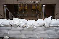 "Shopping arcade in One New York Plaza in the Zone A evacuation zone is sandbagged prior to Hurricane Sandy, in New York on Sunday, October 28, 2012. In advance of the arrival of Hurricane Sandy New York will shut down the subways at 7 PM on Sunday and evacuate low lying ""Zone A"" areas including Battery Park City. In addition the schools will be closed on Monday. (© Frances M. Roberts)"
