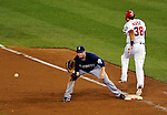 21 June 2011: Seattle Mariners first baseman Justin Smoak gets the ball too late for the out as Michael Morse is able to outrun the throw from Brandon League, as the ball hit his leg in the 9th inning against the Washington Nationals at Nationals Park in Washington, District of Columbia. The Nationals rallied from a 5-1 deficit, scoring 5 runs in the bottom of the 9th, to defeat the Mariners 6-5 in inter-league play. Mandatory Credit: Ed Wolfstein Photo