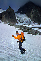 Verwall Gruppe, Ischgl, Austria, July 2004. Mountain guide Gottfried Narr leads the way to the Friedrichshafener Hutte. Trekking from hut to hut in the Verwall Gruppe is a strenuous adventure, however no knowledge of technical mountaineering is necessary. Photo by Frits Meyst/Adventure4ever.com