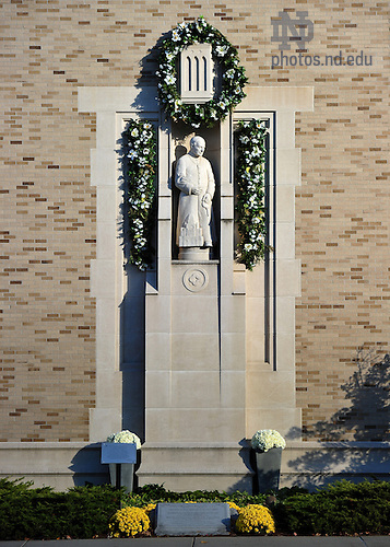Statue of St. Andre Bessette, C.S.C. on the side of the Eck Visitor Center...Photo by Matt Cashore/University of Notre Dame