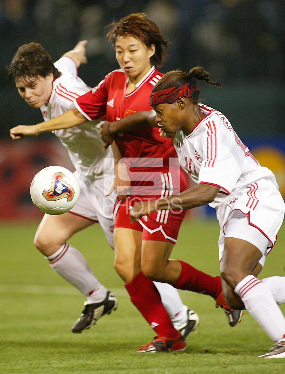 Silvana Burtini (Left, Canada), Wen Sun (Center, China), Charmaine Hooper (right, Canada), China vs. Canada, October 2nd, 2003