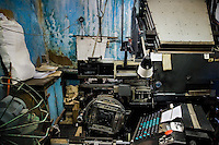 An old printing machine with a type interface in the state print shop, Santiago de Cuba, Cuba, 4 August 2008.