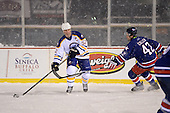 Craig Rivet (52) controls the puck as David Cullen (42) puts on pressure during The Frozen Frontier Buffalo Sabres vs. Rochester Amerks Alumni Game at Frontier Field on December 15, 2013 in Rochester, New York.  (Copyright Mike Janes Photography)