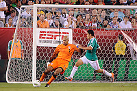 United States goalkeeper Tim Howard (1) clears the ball away from Pablo Barrera (7) of Mexico. The men's national teams of the United States (USA) and Mexico (MEX) played to a 1-1 tie during an international friendly at Lincoln Financial Field in Philadelphia, PA, on August 10, 2011.