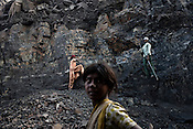 Young children dig out coal from the open cast mines in Borapahari in Jharia, Jharkhand, India. Photo: Sanjit Das