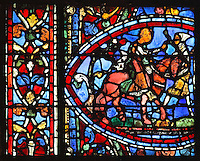 The younger son leaves with his inheritance accompanied by a servant. He rides on a horse with his dog sitting behind him, from the Parable of the Prodigal Son stained glass window, in the north transept of Chartres Cathedral, Eure-et-Loir, France. This window follows the parable as told by St Luke in his gospel. It is thought to have been donated by courtesans, who feature in 11 of the 30 sections. Chartres cathedral was built 1194-1250 and is a fine example of Gothic architecture. Most of its windows date from 1205-40 although a few earlier 12th century examples are also intact. It was declared a UNESCO World Heritage Site in 1979. Picture by Manuel Cohen