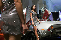 Moscow, Russia, 23/10/2009..Models and sports cars at the Millionaire Fair in Moscow. The event has become an annual fixture, attracting thousands of would-be and existing Russian millionaires to view and purchase a wide range of luxury goods. This year however the fair was much smaller, an indication of how the formerly booming Russian economy has been hit by the world financial crisis.