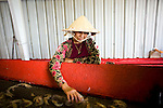 Hung Nguyen inspects her shrimp that her boat brought in from more than 8 hours away to the Dean Blanchard Seafood, Inc. in Grand Isle, LA on June 24, 2010 where a fishing ban has been put in place due to the B.P. oil spill. The seafood company once was working 24 hours a day and seven days a week during shrimping season, but has reduced operating hours and mostly sells gas and ice now. The company also laid off almost 80 workers according to owner, Dean Blanchard.