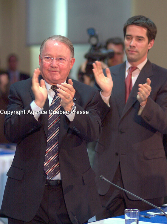 June 6 , 2002, Montreal, Quebec, Canada<br /> <br />  Bernard Landry, Quebec Premier (L) and<br /> Andre Boisclair, Quebec Minister Municipal Affairs,<br /> Quebec Minister Environment applaud (R)<br />  after Gerald Tremblay, Montreal Mayor <br /> speech at  the closing  of the Montreal Summit<br />  (Le Sommet de Montr&Egrave;al), June 6, 2002<br /> <br /> <br />  <br /> Mandatory Credit: Photo by Pierre Roussel- Images Distribution. (&copy;) Copyright 2002 by Pierre Roussel <br /> ON SPEC<br /> NOTE l Nikon D-1 jpeg opened with Qimage icc profile, saved in Adobe 1998 RGB.