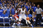 30 October 2015: Duke's Amile Jefferson (21) and Florida Southern's Dominique Williams (left). The Duke University Blue Devils hosted the Florida Southern College Moccasins at Cameron Indoor Stadium in Durham, North Carolina in a 2015-16 NCAA Men's Basketball Exhibition game. Duke won the game 112-68.
