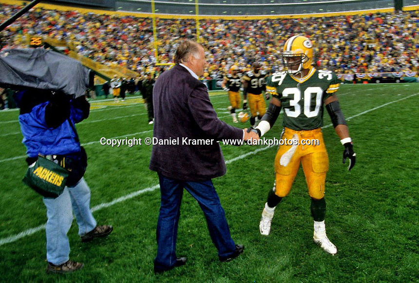 Former Green Bay Packer Jerry Kramer greets Packers running back Ahman Green on Lambeau Field prior to the 2001 home opener against the Detroit Lions. Part of the Packers' commitment to the fans involves bringing back past Packers for an alumni appreciation day.
