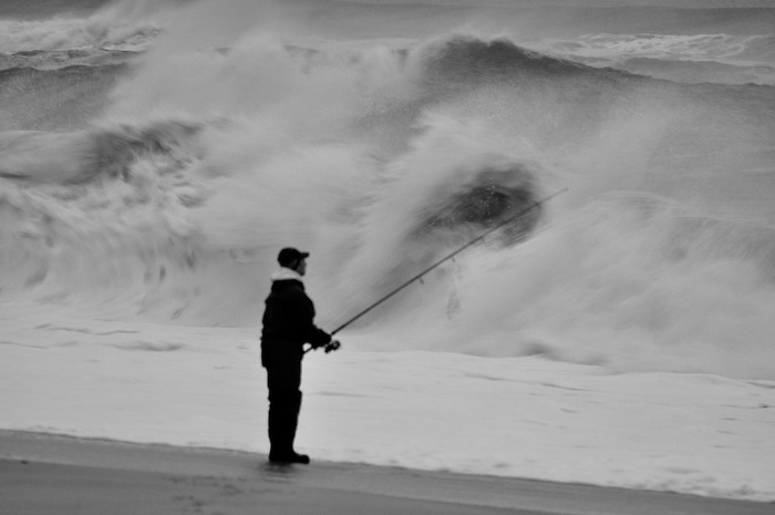 Fisherman in the waves at Fire Island