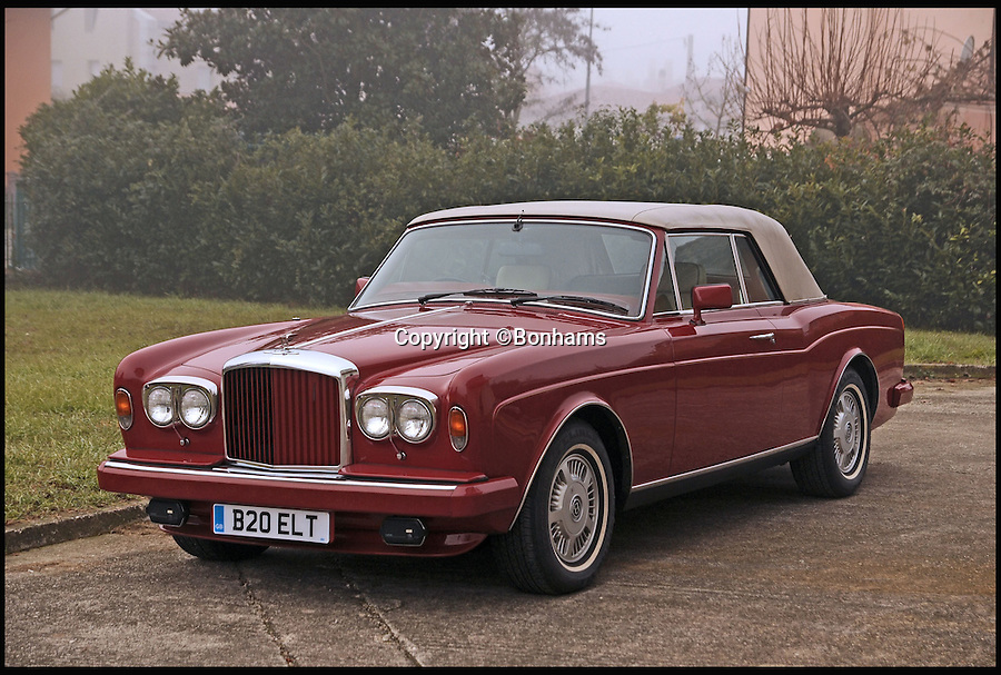BNPS.co.uk (01202 558833)<br /> PIc: Bonhams/BNPS<br /> <br /> ***Please Use Full Byline***<br /> <br /> The 1985 Continental Bentley Convertible. <br /> <br /> The plush Bentley car that starred in the video for Elton John's cold war hit Nikita has emerged for sale for &pound;70,000.<br /> <br /> The convertible red Bentley Continental took pride of place in the video for the 1985 hit single about a beautiful female Russian border guard called Nikita.<br /> <br /> The video featured Sir Elton sat in the luxury motor taking photos of Nikita from afar before making several failed attempts to drive it through her checkpoint.<br /> <br /> The Bentley is going under the hammer at auctioneers Bonhams in Paris on February 5.