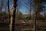 Children play on a swingset in the Makish Roma relocation camp.
