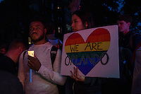 NEW YORK JUNE 13: People hold candles and banners during a vigil in solidarity outside Manhattan's historic Stonewall Inn to express their support for the victims killed at Pulse nightclub in Orlando in New York on June 13 ,2016. Photo by VIEWpress/Maite H. Mateo.