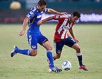 CARSON, CA – SEPTEMBER 19: KC Wizard midfielder Davy Arnaud (22) and Chivas USA defender Jonathan Bornstein (13) during a soccer match at Home Depot Center, September 19, 2010 in Carson California. Final score Chivas USA 0, Kansas City Wizards 2.