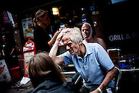 Oslo, Norway, 22.07.2011. An emplyee at the government offices attempts to stop a bleeding in his head. On 22 July 2011, Anders Behring Breivik bombed the government buildings in Oslo, which resulted in eight deaths. He then carried out a mass shooting at a camp of the Workers' Youth League (AUF) of the Labour Party on the island of Ut&oslash;ya where he killed 69 people, mostly teenagers. Photo: Christopher Olss&oslash;n. ..----------------------------..-ITALY OUT-..----------------------------