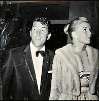 BNPS.co.uk (01202 558833)<br /> Pic: DominicWinter/BNPS<br /> <br /> The 'King of Cool' Dean Martin with his then wife Jeanne Biegge.<br /> <br /> A remarkable set of 430 candid photographs of Hollywood royalty have been unearthed after 50 years.<br /> <br /> Included in the collection of unpublished pictures are snaps of silver screen icons Paul Newman, Charlie Chaplin, Bette Davis, Audrey Hepburn, and Dean Martin.<br /> <br /> Paul Newman is captured looking over his shoulder at the wheel of his car and Charlie Chaplin is pictured without his trademark moustache. <br /> <br /> Audrey Hepburn has posed with her then husband actor Mel Ferrer while Bette Davis can be seen puffing on a cigarette.<br /> <br /> The snaps were taken by obsessive amateur photographer Dwight 'Dodo' Romero from 1954 to 1967 who would hang around at Hollywood parking lots and other hang-outs to catch a glimpse of the stars.<br /> <br /> The photos, which more recently belonged to a book dealership in York, have emerged for auction and are tipped to sell for &pound;800.