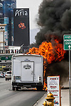 06-12-2013 This afternoon about 3:30 PM a Beltran shuttle bus coming from the airport spontaneously combusted on Las Vegas Blvd And Reno into flames .. it appears that all the passengers on the bus made it off safely..