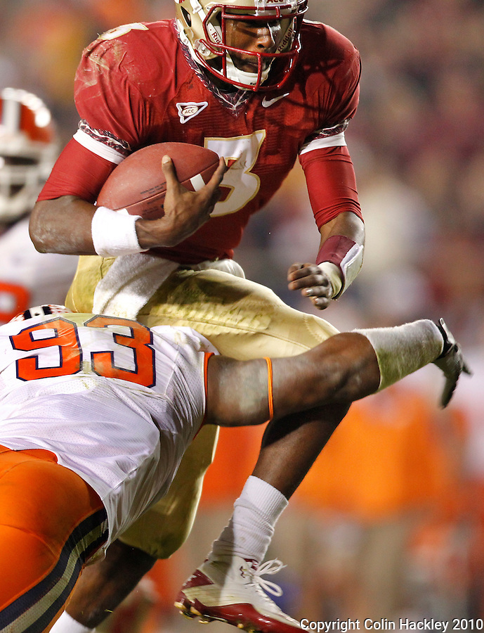 TALLAHASSEE, FL 11/13/10-FSU-CLEMSON FB10 CH-Florida State's EJ Manuel tries to hurdle past Clemson's Da'Quan Bowers during second half action Saturday at Doak Campbell Stadium in Tallahassee. The Seminoles beat the Tigers 16-13..COLIN HACKLEY PHOTO