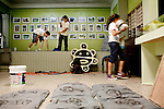 Grade school students prepare for the 39th annual Festival Indigena de Jayuya at the Instituto de Cultural Puertorriqueña, a cultural center in Jayuya, Puerto Rico, on Tuesday, November 18, 2008. The sun petroglyph represents the Taino Indians in Jayuya.