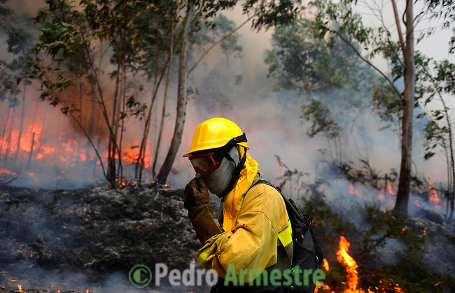 A member of the BRIF (Brigade to reinforce wildfires) of Tineo, in Asturias works around the fire area in Boiro, on August 15, 2010, near A Coruña. Pedro ARMESTRE