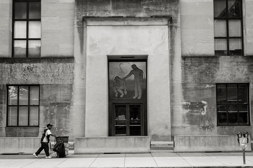A federal employee walks by a government building in Washington DC