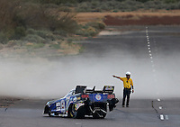 Feb 22, 2014; Chandler, AZ, USA; A member of the NHRA safety safari directs funny car driver Robert Hight off the track as dust blows during qualifying for the Carquest Auto Parts Nationals at Wild Horse Pass Motorsports Park. Mandatory Credit: Mark J. Rebilas-USA TODAY Sports