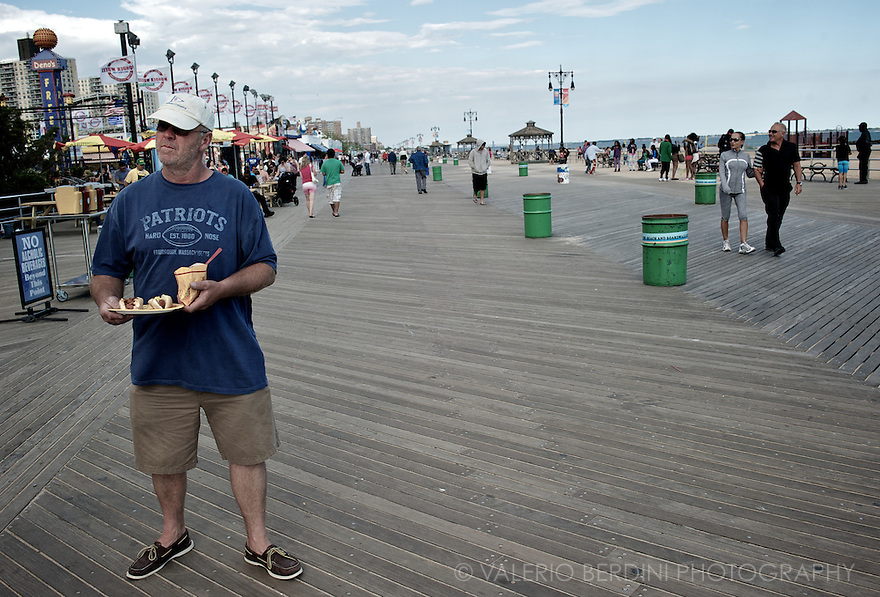 Hot dogs. Shorts. Hat. Patriots t-shirt. Boardwalk. Seaside. USA