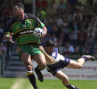 Sport , Rugby, Zurich Championship, 01/06/2002, Bristol v Northampton, Agustin Pichot hangs onto Saints blindside flanker Andrew Blowers.   [Mandatory Credit, Peter Spurier/ Intersport Images].