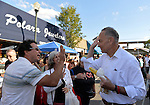 "Bellmore, New York, U.S. 22nd September 2013. U.S. Senator CHARLES ""CHUCK"" SCHUMER  (Democrat), running for re-election in November, and a man slap ""high five"" while talking to each other during the senator's campaign visit at the 27th Annual Bellmore Festival, featuring family fun with exhibits and attractions in a 25 square block area, with over 120,000 people expected to attend over the weekend."