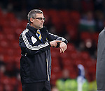 Craig Levein checking his watch