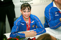 Oct 19, 2006; Aarhus, Denmark; Portrait is of Ferrari of Italy (1st) during interviews after winning women's gymnastics ALL-Around gold at 2006 World Championships Artistic Gymnastics. Photo by Tom Theobald<br />