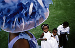 Brides maids waits to be photographed, after the wedding for Yolissa Koza, a consultant for an international management consulting on April 19, 2003 at an exclusive lodge in Muldersdrift outside Johannesburg, South Africa. Yolissa and her husband Sandile, belong to the new black elite in the country. The couple, educated and connected, has successful careers and has money to spend on luxury items and western influenced lifestyle. They invited five hundred guests to the western styled wedding. (Photo by: Per-Anders Pettersson)
