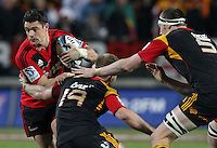 Crusaders' Dan Carter is tackled by Chiefs' Sam Cane and Brodie Retallick in the semi-final Super Rugby match, Waikato Stadium, Hamilton, New Zealand, Friday, July 27, 2012.  Credit:SNPA / David Rowland