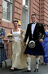 Europe, United Kingdom, Great Britain, Scotland, Edinburgh. A newly married Scottish bride and groom.