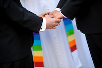 Two grooms tie the knot during a wedding ceremony in New Jersey.